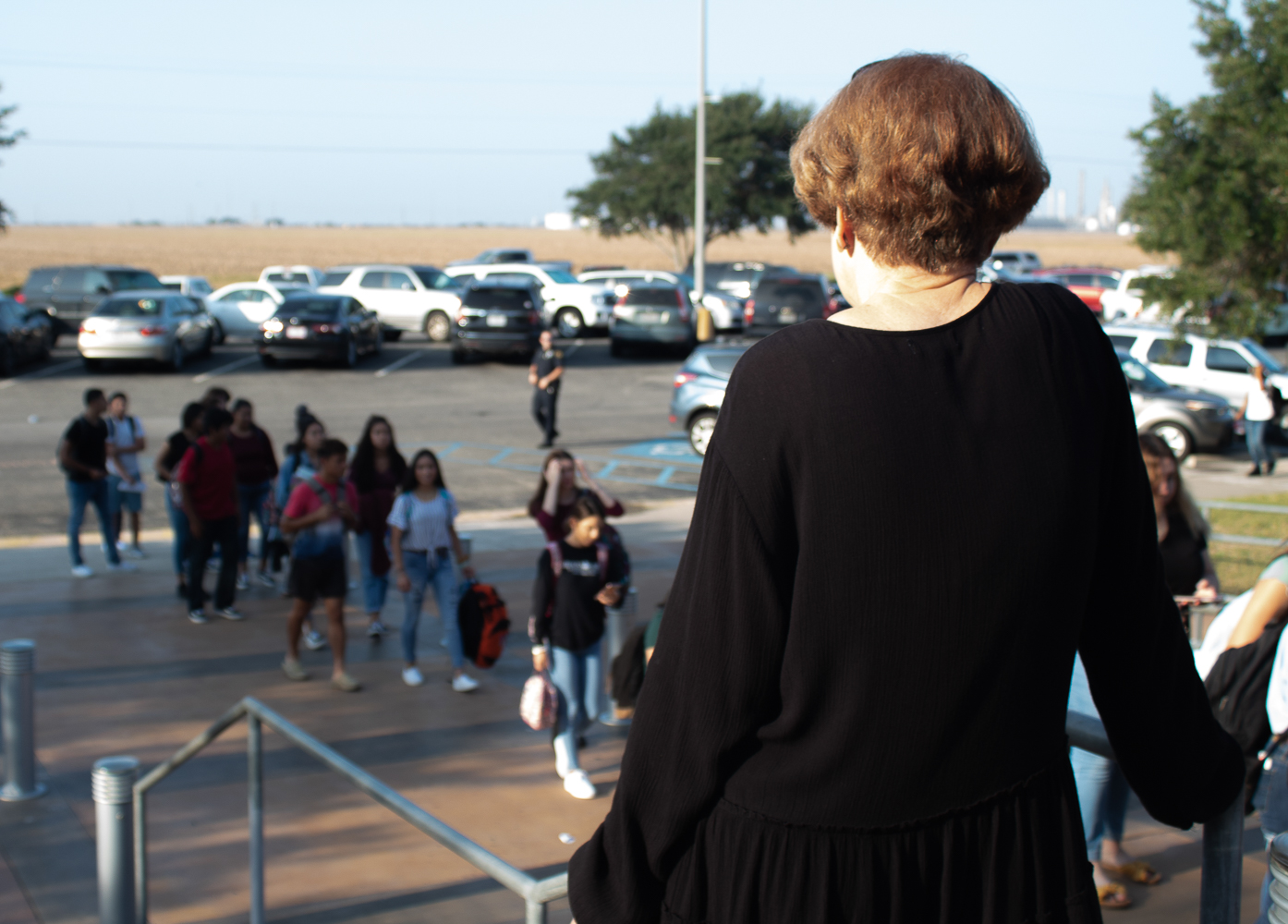 Mrs.+Birdwell+keeps+watch+as+students+wait+to+have+their+bags+checked.